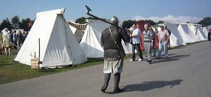 A warrior welcomes people to an LHE in 2013